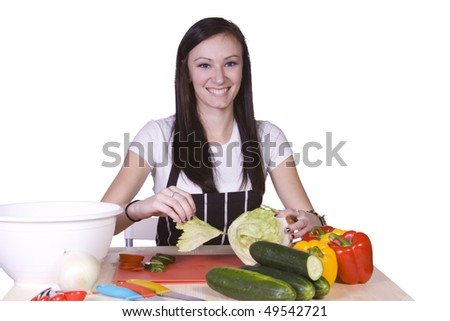 Cute Teenager in the Kitchen Preparing Food - stock photo