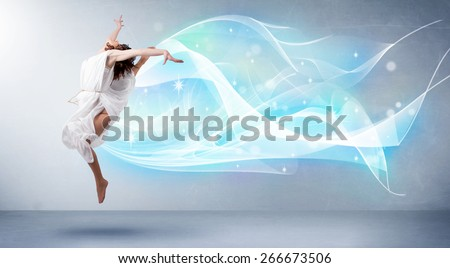 Cute teenager jumping with abstract blue scarf around her concept on background - stock photo