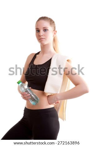 Cute teenager with bottle of water in hands and towel on shoulder after sport. Isolated over white background. Studio shooting - stock photo