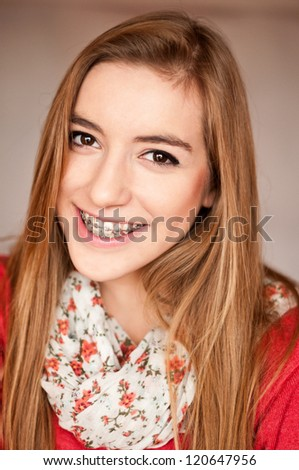 cute teenager with brace - stock photo