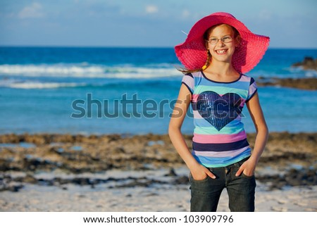 Cute teens girl in hat relax ocean background - stock photo