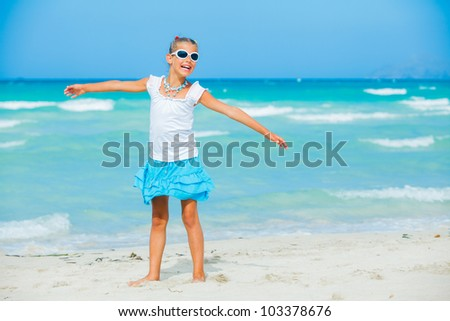 Cute teens girl in sunglasses relax ocean background - stock photo