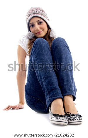 cute teens girl sitting on the floor on an isolated white background - stock photo
