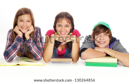 Cute teens with books smiling at camera - stock photo