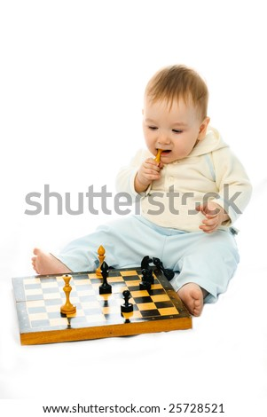 cute ten months old baby sitting on the floor and playing chess - stock photo