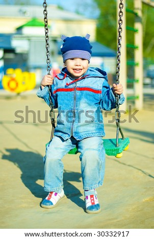 cute three year old boy having fun in the park outdoor