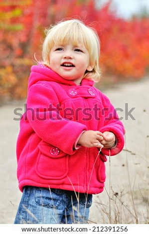 cute toddler girl in fall park - stock photo