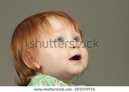 Cute toddler looks up