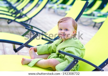 Cute toddler sitting on lounge chair stock photo 192308732 for Toddler sitting chair
