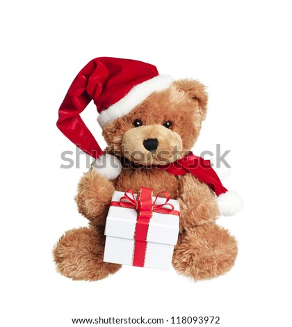 Cute toy bear with christmas gift and santa hat on white background - stock photo