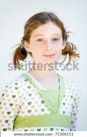 cute twelve year old girl with pigtails - stock photo