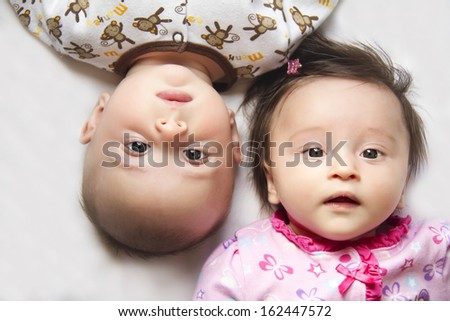 Cute twins, a boy and a girl - stock photo