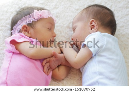 Cute twins sleeping together, a boy and a girl