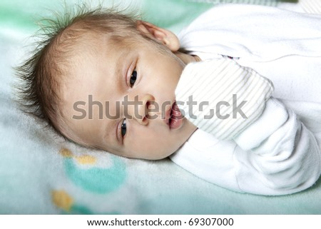 Cute two month baby on bed - stock photo