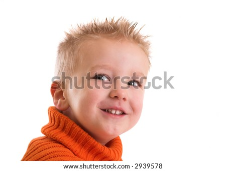 Cute two year old boy with a cheeky grin on his face - stock photo