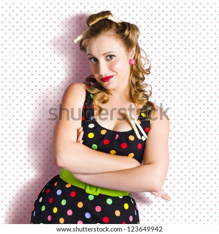 Cute Vintage House Maid With Old Wooden Pegs In Hair On Retro Polka Dot Background With Copyspace - stock photo