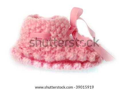 Cute wolen baby shoe on white background - stock photo