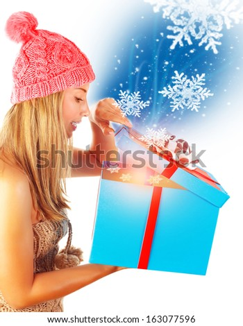 Cute woman getting Xmas gift, isolated on white background, happy facial expression, miracle on New Year eve, winter holidays concept - stock photo