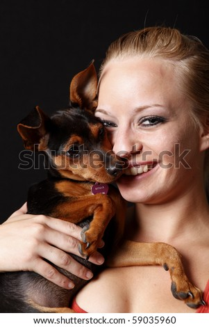 Cute woman holding her puppy.