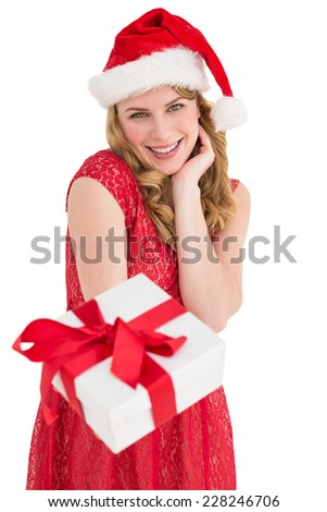 Cute woman in red dress offering gift on white background