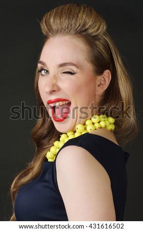Cute woman in retro style, winking - stock photo