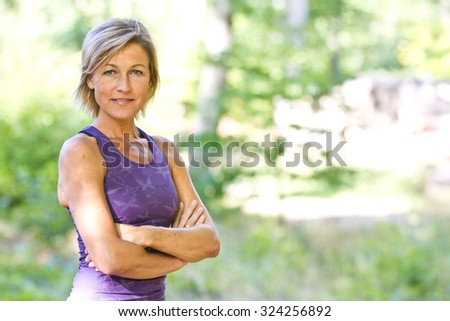 Cute woman is sporty situation in a forest - stock photo
