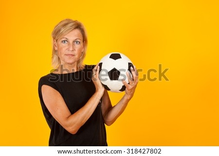 Cute woman portrait with yellow background