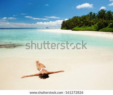 Cute woman relaxing on the tropical beach - stock photo