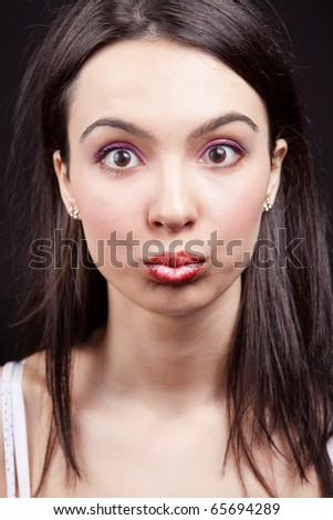 Cute woman with funny and surprise expression on her face - stock photo