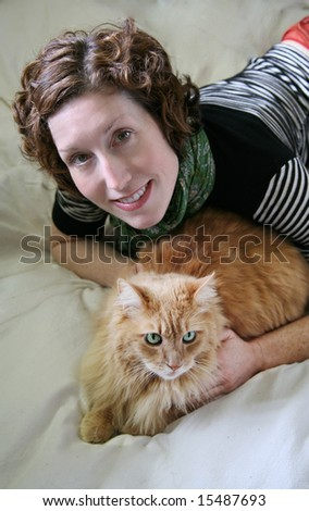 Cute Woman with her Cat from above - stock photo