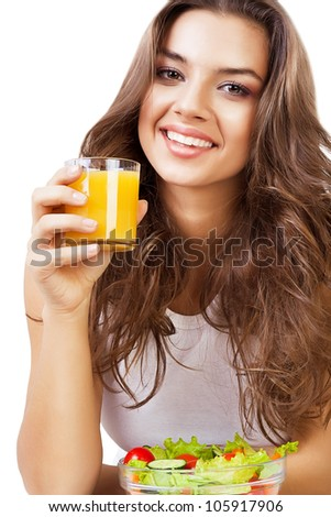 cute woman with juice and salad on white background - stock photo