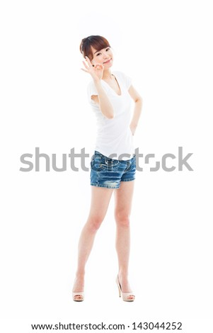 Cute woman with okay hand gesture isolated on white background. - stock photo