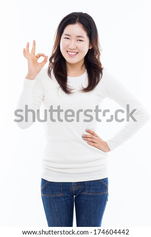 Cute woman with okay hand gesture isolated on white background.
