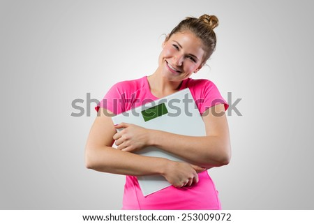 Cute woman with weight scale - stock photo