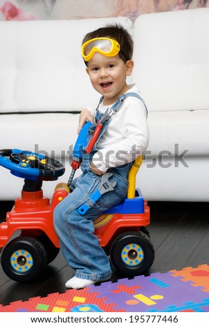 Cute 3 year old boy dressed as a construction worker - stock photo