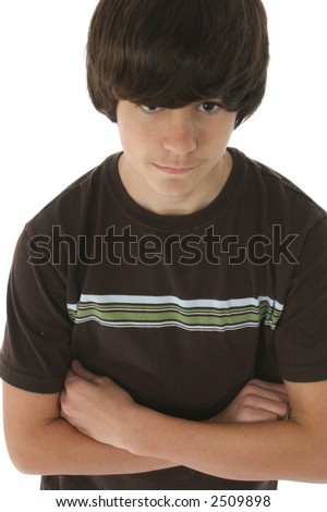 Cute 13 year old boy with arms crossed. White background.