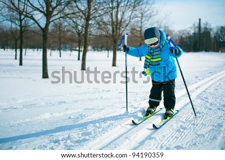 Cute 3 years old boy skiing on cross - stock photo