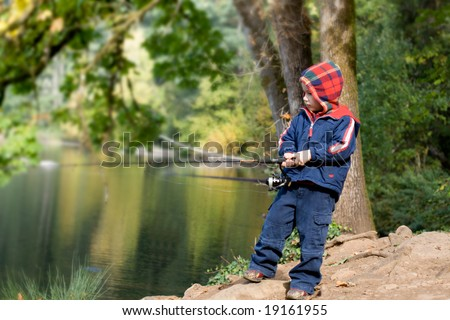 Cute 4 years old fisher boy - stock photo