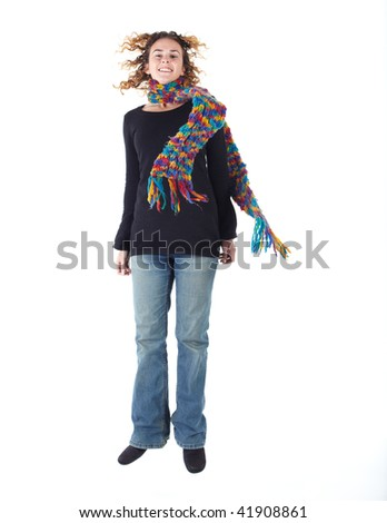 Cute young adult caucasian woman curly red hair in a black top, blue jeans and a colorful scarf on a white background in various poses, with various facial expressions. Not Isolated