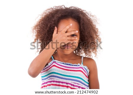 Cute young African American girl hiding her eyes, isolated on white background - Black People - stock photo