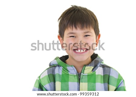 Cute young asian boy with great smile wearing a colorful sweater isolated on white background - stock photo
