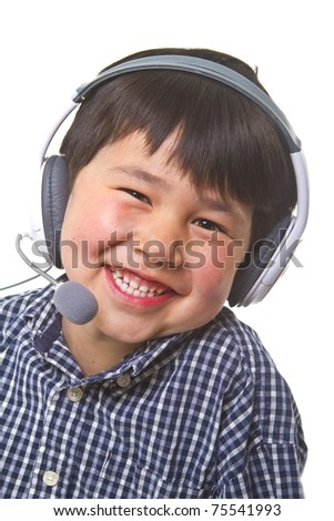 Cute young asian boy with great smile wearing a gaming headset  isolated on white background - stock photo