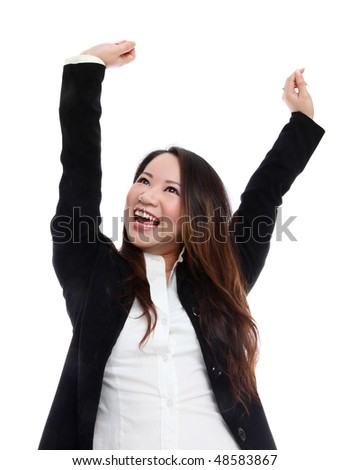 Cute young asian business woman celebrating success - stock photo