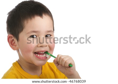 Cute young boy brushing his teeth isolated on white background