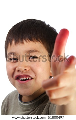 Cute young boy pointing his finger and smiling isolated on white background - stock photo