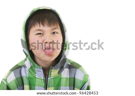 Cute young boy sticking out his tongue isolated on white background - stock photo