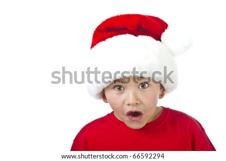 Cute young boy with Christmas Santa hat isolated on white background - stock photo