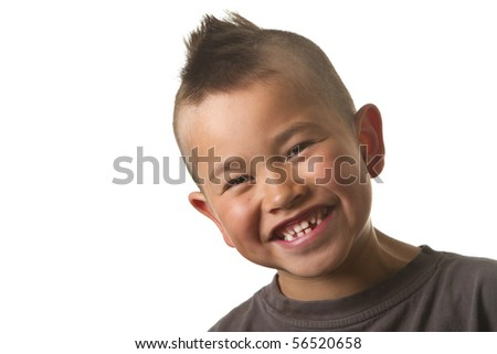 Cute young boy with funny mohawk haircut isolated on white background