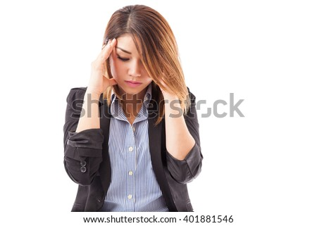 Cute young brunette in a business suit touching her temple and feeling stressed because of work - stock photo