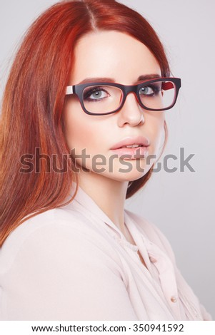 Cute young business woman with glasses, studio shoot